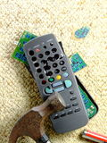Smashed TV Remote. A television remote control that has smashed and broken with a hammer royalty free stock images