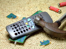 Smashed TV Remote. A television remote control that has smashed and broken with a hammer Royalty Free Stock Image
