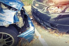 A smashed up car after an accident leaves a wreck Stock Photos