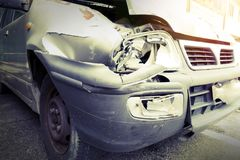 A smashed up car after an accident leaves a wreck Royalty Free Stock Photos
