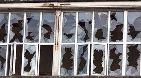 Smashed window array Stock Photography