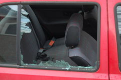 Smashed window car. A red car with a broken window Stock Photography