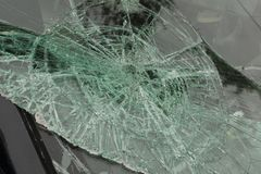 Smashed windscreen. Or windshield on a car in close up ideal for vehicle insurance claim or vandalism concepts Royalty Free Stock Photography