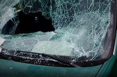 Smashed windshield of wrecked car Stock Photo