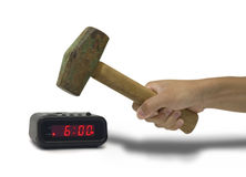 Smashing an Alarm Clock. Hitting an alarm clock with a sledge hammer Stock Images