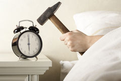 Smashing Alarm Clock with Hammer Stock Photography
