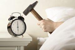 Smashing Alarm Clock with Hammer Stock Photography