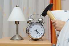 Smashing Alarm Clock with Hammer Royalty Free Stock Photo