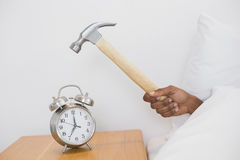 Smashing alarm clock with hammer Royalty Free Stock Photography