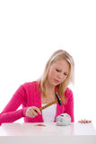 Smashing the bank. Pretty teen with a hammer about to smash her piggybank Stock Images