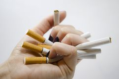 Smashing cigarettes Royalty Free Stock Images