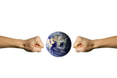 Smashing the Earth 2. Two hands trying to smashing the blue earth Stock Photography