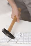 Smashing keyboard with hammer Royalty Free Stock Images