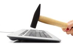 Smashing keyboard with  hammer Royalty Free Stock Photo