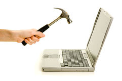 Smashing laptop with a hammer. Smashing the computer with a hammer. Concept of stress/anger Stock Image