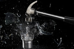 Smashing a light bulb Stock Photos