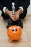Smashing piggy bank royalty free stock photo