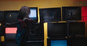 Smashing TV wall in slow motion with crowbar 4K. Shoot at ARRI Alexa and anamorphic lense stock video footage