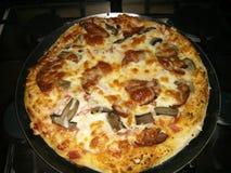 smaskig pizza arkivfoto