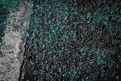 Broken car window glass on the sidewalk. A smattering of broken glass from a window that was broken by a thief Royalty Free Stock Photo