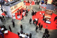 Smau 2009. Panoramic view of bussiness men walking trough stands at SMAU, international fair of communications, business intelligence and information technology Stock Image