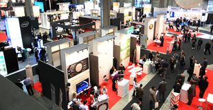 Smau 2010. Panoramic view of people visiting stands at SMAU, international fair of communications, business intelligence and information technology October 20 Royalty Free Stock Photo