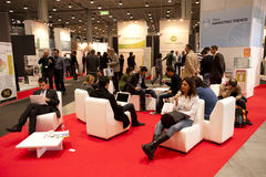 SMAU 2010 - relax. MILAN, ITALY - OCT 21: people resting during SMAU 2010, International Exhibition of Information and Communication Technology on October 21 Royalty Free Stock Photography