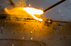 SMAW – Shielded metal arc welding and welding flame. SMAW – Shielded metal arc welding and welding flame at spark area Royalty Free Stock Photo