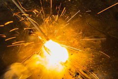 SMAW – Shielded metal arc welding and welding flame. SMAW – Shielded metal arc welding and welding flame at spark area Royalty Free Stock Image