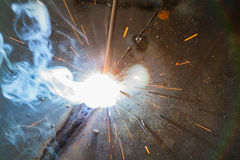 SMAW – Shielded metal arc welding and welding fumes. Royalty Free Stock Image