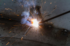 SMAW – Shielded metal arc welding and welding fumes. Royalty Free Stock Images