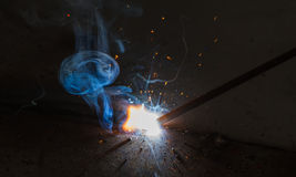 SMAW – Shielded metal arc welding and welding fumes. Stock Photo