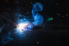SMAW – Shielded metal arc welding and welding fumes. Stock Images