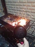 Smazzi nel fuoco Immagini Stock
