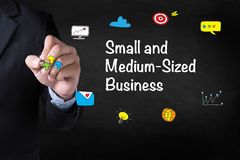 SMB - Small and Medium-Sized Business. Businessman drawing Landing Page on blurred abstract background Stock Images