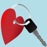 Símbolo del corazón y clave del coche en un anillo brillante Foto de archivo libre de regalías