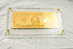 Símbolo dourado do dólar Imagem de Stock