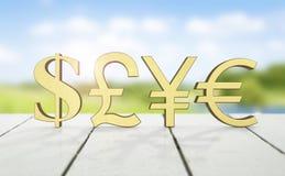 Símbolos de dinero en circulación de oro Fotos de archivo