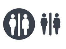 Símbolos del retrete en el fondo blanco Siluetas blancas en un círculo gris oscuro y un icono gris oscuro del varón y femenino en Imagenes de archivo