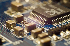 Smd components on pc motherboard. Macro shot of smd components on pc motherboard Stock Photos