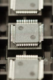 SMD integrated circuits. On tray - macro small DOF Royalty Free Stock Photos