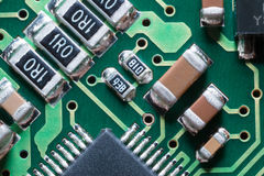 SMD resistors and condensers. Macro of SMD circuit board: resistors and condensers Stock Photography