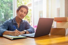 SME business owners checking inventory with laptop on the table. stock photos