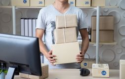 SME,small business seller holding box prepare for sent to customer stock photos
