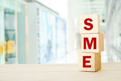 SME , Small and Medium Enterprise , business word on wooden cube. S background, with copy space for text royalty free stock images