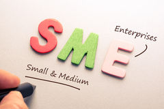 SME. Wood letter of SME with hand writing definition Stock Image