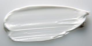 Smear cream isolated on white background. Stock Images