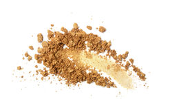 Smear of crushed gold eyeshadow royalty free stock photography