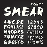 Smear hand painted font on chalkboard Stock Images