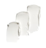 Smear paint of white cosmetic products Royalty Free Stock Photography